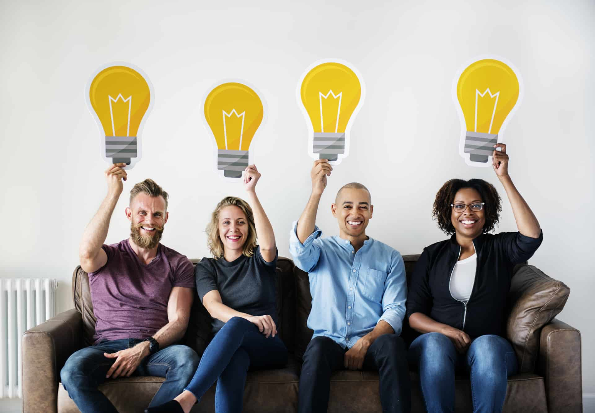 Risk and rewards of innovation, group of people holding idea lightbulbs