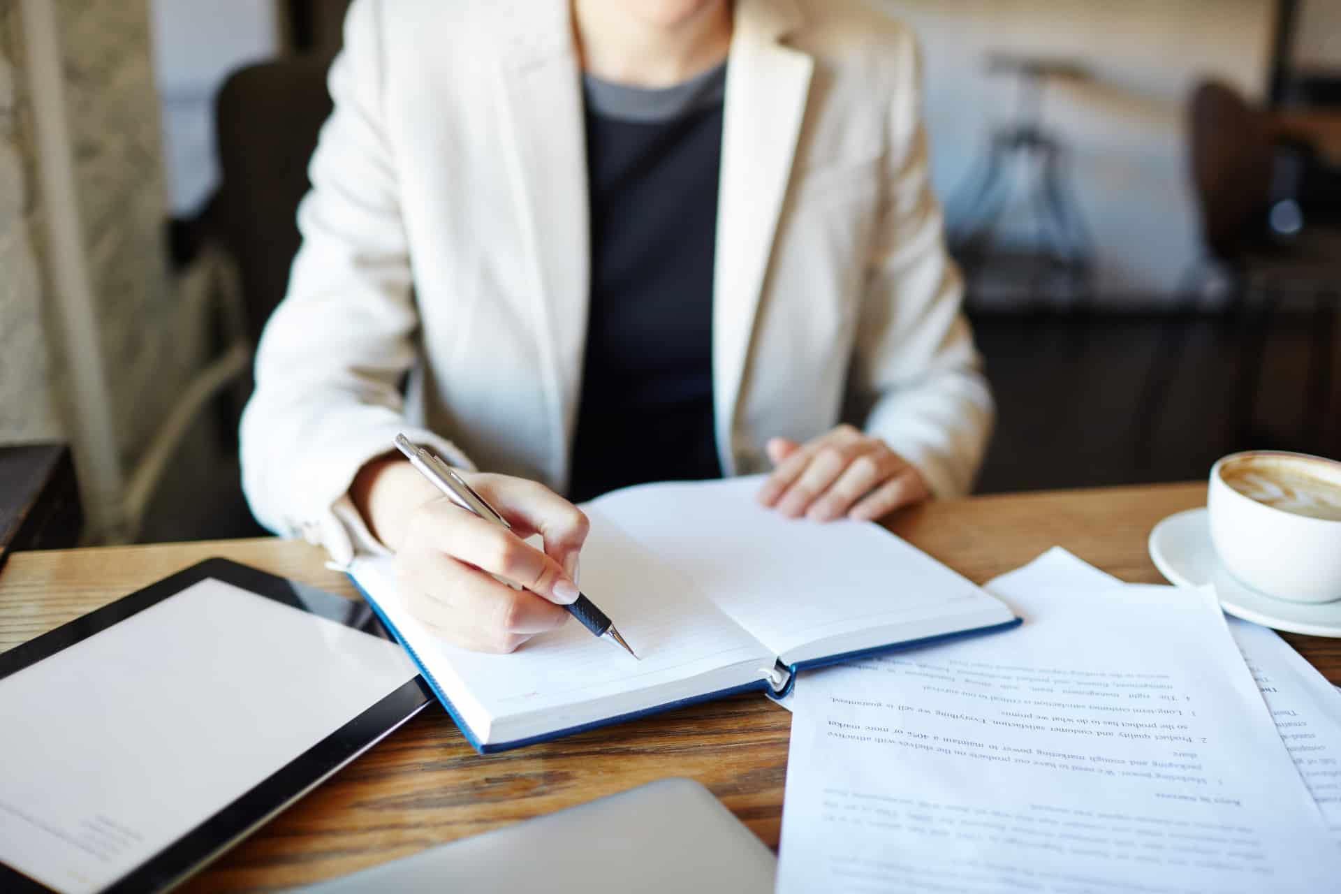 Executive writing in diary